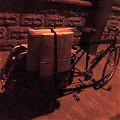 Xtracycle carrying parceled paintings at night