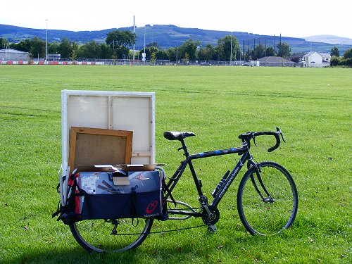 photo of my bicycle with the xtracycle extension, carrying some large canvases