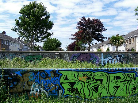 Walls of graffiti at the end of a suburban Dublin road