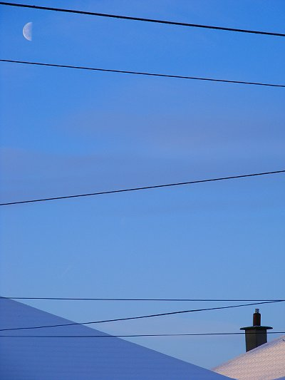 Half Moon over Snowy Roofs in Dublin West, Ireland