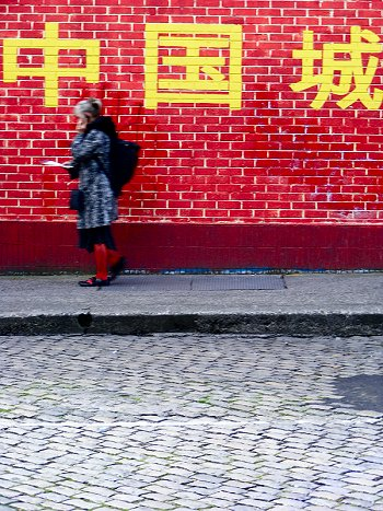 Pedestrian at Chinese red wall