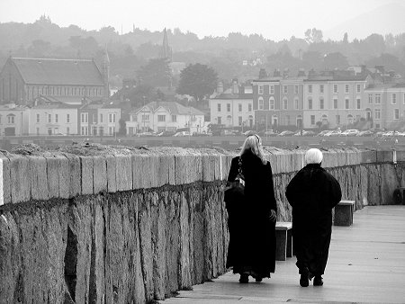 2 women walking on the east pier at Dun Laoghaire