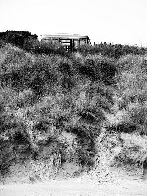 a caravan and path through the dunes to the beach