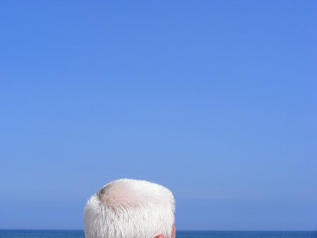 Ireland, a blue sky over the Irish sea, and a head of white hair