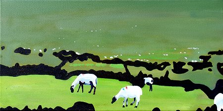Sheep, near and far, in fields at he bottom of a mountain